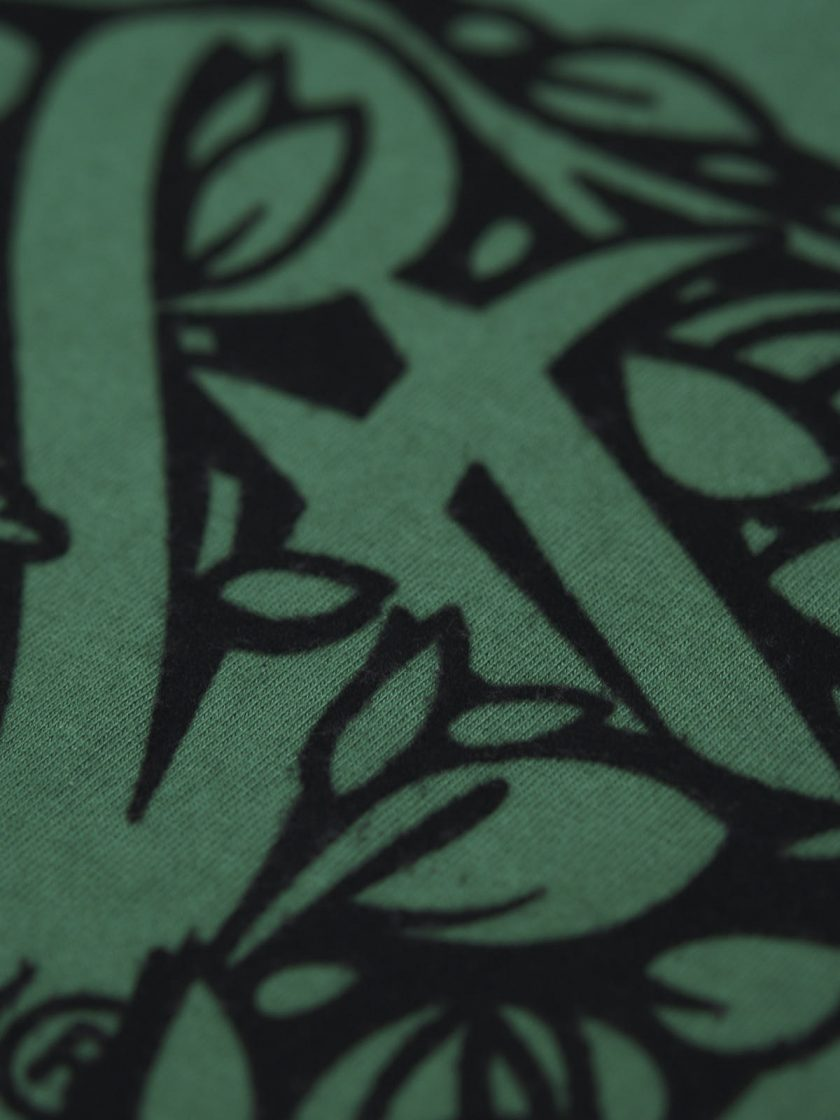 close up flocking dusk green tee